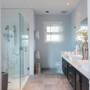 Transitional master gray tile and ceramic tile ceramic floor walk-in shower photo in Vancouver with a vessel sink, shaker cabinets, quartz countertops, blue walls and dark wood cabinets