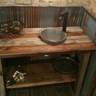 На фото: маленькая ванная комната в стиле рустика с открытыми фасадами, искусственно-состаренными фасадами, полом из линолеума, душевой кабиной, накладной раковиной и столешницей из дерева с