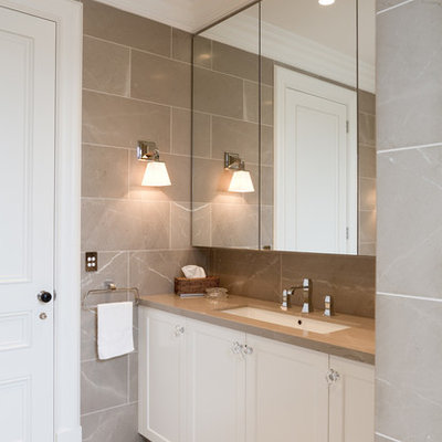 Bathroom - mid-sized traditional master gray tile and stone tile marble floor bathroom idea in Sydney with an undermount sink, recessed-panel cabinets, white cabinets, marble countertops, gray walls and brown countertops