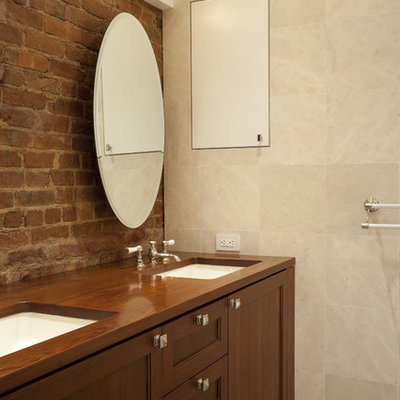 Example of an eclectic beige tile bathroom design in New York with an undermount sink, shaker cabinets and medium tone wood cabinets