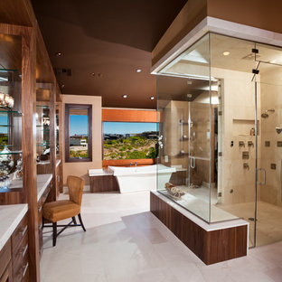 Large trendy master beige tile and stone tile marble floor bathroom photo in Las Vegas with an undermount sink, flat-panel cabinets, medium tone wood cabinets, brown walls and marble countertops