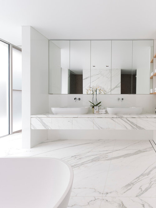 Example of a large minimalist master white tile and marble tile  freestanding bathtub design in Sydney