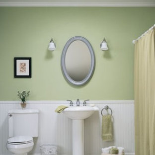Inspiration for a mid-sized timeless master white tile tub/shower combo remodel in Minneapolis with a pedestal sink, a two-piece toilet and green walls