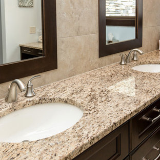 Example of a classic bathroom design in Other with granite countertops