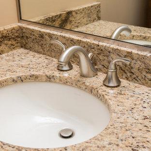 Elegant bathroom photo in Other with granite countertops
