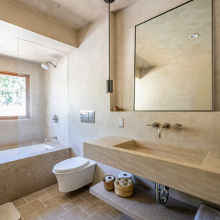 Inspiration for a southwestern beige floor and single-sink bathroom remodel in Los Angeles with beige walls, an integrated sink, beige countertops and a floating vanity