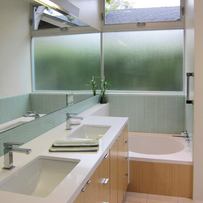 Inspiration for a modern blue tile and glass tile alcove bathtub remodel in Los Angeles with an undermount sink, flat-panel cabinets, light wood cabinets and white countertops