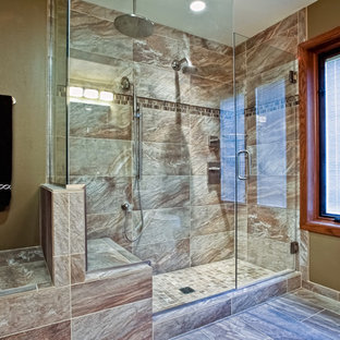 Example of a mid-sized transitional 3/4 brown tile and stone tile porcelain floor corner shower design in Other with an undermount sink, flat-panel cabinets, medium tone wood cabinets, limestone countertops, a two-piece toilet and brown walls