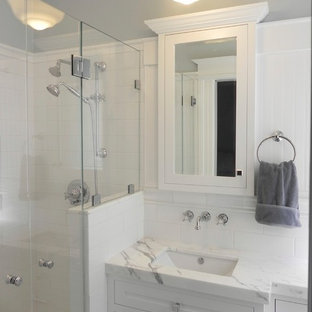 Inspiration for a small timeless master white tile and ceramic tile mosaic tile floor alcove shower remodel in San Francisco with shaker cabinets, white cabinets, blue walls, an undermount sink, marble countertops and a one-piece toilet