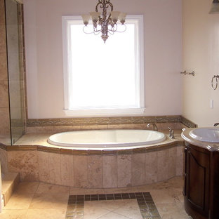 Bathroom - mid-sized traditional master beige tile and stone tile travertine floor bathroom idea in San Luis Obispo with furniture-like cabinets, dark wood cabinets, marble countertops, a drop-in sink and beige walls