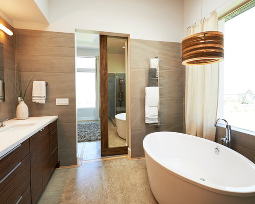 Example Of A Trendy Gray Tile Freestanding Bathtub Design In Salt Lake City With An Undermount