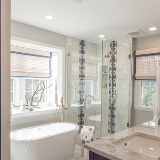 Example of a small eclectic master gray tile and marble tile marble floor and gray floor bathroom design in DC Metro with shaker cabinets, blue cabinets, a two-piece toilet, gray walls, an undermount sink, marble countertops, a hinged shower door and gray countertops