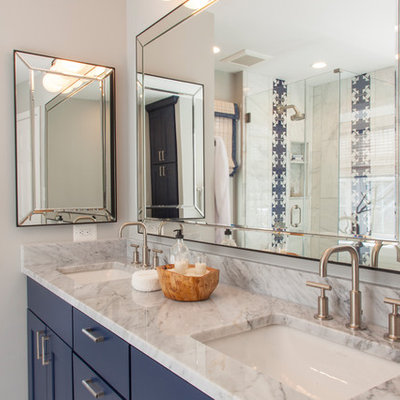 Example of a small transitional master marble tile marble floor and gray floor bathroom design in DC Metro with shaker cabinets, blue cabinets, gray walls, an undermount sink, marble countertops and gray countertops