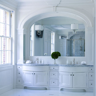 Inspiration for a timeless bathroom remodel in New York with marble countertops