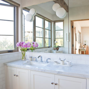 Mountain style bathroom photo in Santa Barbara with recessed-panel cabinets and white cabinets