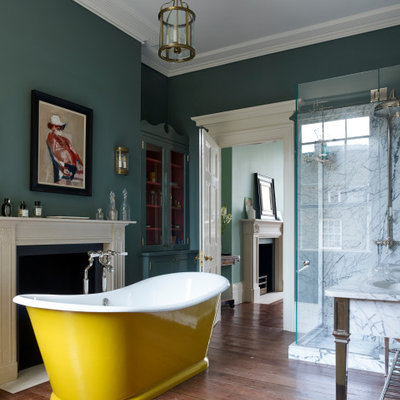 Bathroom - mid-sized victorian master white tile and marble tile medium tone wood floor and brown floor bathroom idea in London with a hinged shower door and green walls