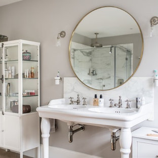 Medium sized traditional bathroom in Dorset with grey walls, a console sink, white worktops, a freestanding bath, marble tiles and marble worktops.