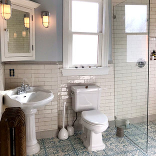Inspiration for a mid-sized victorian master wet room bathroom in Seattle with shaker cabinets, white cabinets, a claw-foot tub, a two-piece toilet, ceramic tile, blue walls, cement tiles, a pedestal sink, blue floor and an open shower.