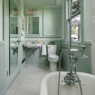 Claw-foot bathtub - victorian white tile and ceramic tile vinyl floor and gray floor claw-foot bathtub idea in Portland with a two-piece toilet, green walls and a console sink