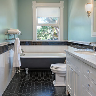 Freestanding bathtub - victorian master porcelain tile ceramic tile and black floor freestanding bathtub idea in San Francisco with shaker cabinets, white cabinets, a one-piece toilet, green walls and marble countertops