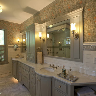 Traditional bathroom in Boston with marble benchtops.