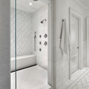 Inspiration for a mediterranean master white tile marble floor and white floor bathroom remodel in Chicago with white cabinets, white walls and a hinged shower door