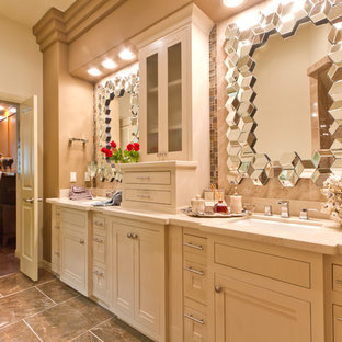 This is an example of a large mediterranean ensuite bathroom in Austin with recessed-panel cabinets, beige cabinets, beige walls, vinyl flooring, laminate worktops and beige floors.