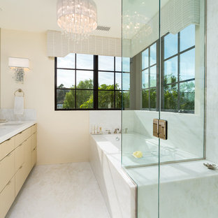 Mid-sized tuscan master white tile and marble tile marble floor and white floor corner shower photo in Los Angeles with flat-panel cabinets, yellow cabinets, an undermount tub, a one-piece toilet, beige walls, an undermount sink, marble countertops and a hinged shower door