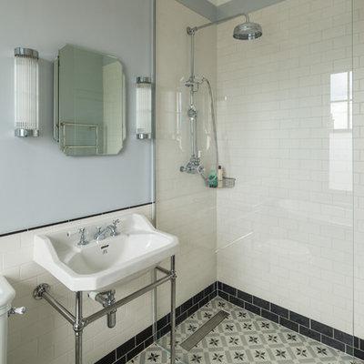 Bathroom - victorian 3/4 bathroom idea in London with blue walls and a wall-mount sink