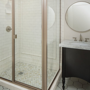 Inspiration for a transitional white tile and subway tile alcove shower remodel in Salt Lake City with furniture-like cabinets, black cabinets and marble countertops