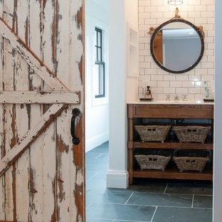 Ispirazione per una stanza da bagno padronale stile rurale di medie dimensioni con lavabo da incasso, top in marmo, piastrelle bianche, piastrelle diamantate, pareti bianche, pavimento con piastrelle in ceramica, nessun'anta, vasca freestanding e ante in legno bruno