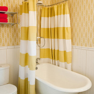 Inspiration for a contemporary bathroom in Austin with a freestanding tub, a two-piece toilet and yellow walls.