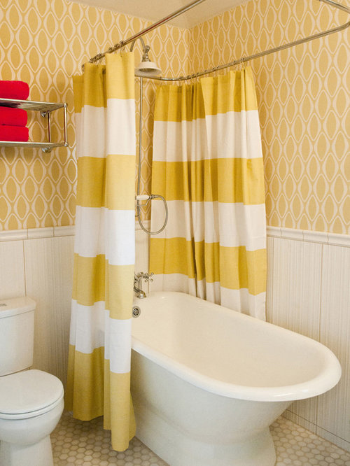 bathtub idea in austin with a twopiece toilet and yellow walls
