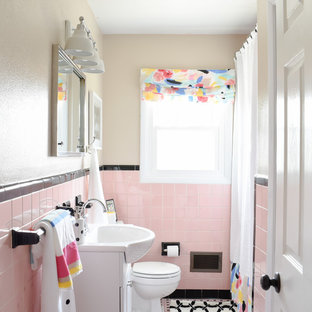 Photo of a mid-sized midcentury kids bathroom in Nashville with a drop-in tub, beige tile, ceramic tile, pink walls, ceramic floors and pink floor.