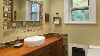 Vintage sideboard, glass accent tile and modern plumbing fixtures