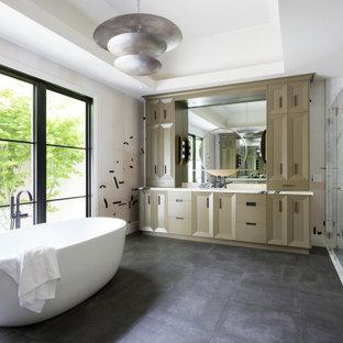 Идея дизайна: главная ванная комната среднего размера в современном стиле с отдельно стоящей ванной, угловым душем, белой столешницей, встроенной тумбой, обоями на стенах, фасадами с утопленной филенкой, коричневыми фасадами, белой плиткой, плиткой из листового камня, разноцветными стенами, врезной раковиной, черным полом, душем с распашными дверями, тумбой под одну раковину и многоуровневым потолком