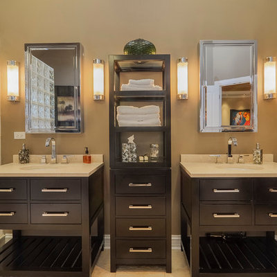 Transitional bathroom photo in Chicago with an undermount sink, flat-panel cabinets, dark wood cabinets and marble countertops