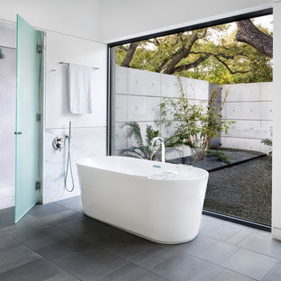 This is an example of a large retro ensuite bathroom in Austin with a freestanding bath, a built-in shower, white tiles, mosaic tiles, white walls, porcelain flooring, grey floors and a hinged door.