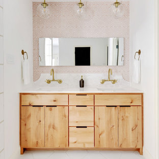 Example of a beach style white floor bathroom design in Austin with flat-panel cabinets, light wood cabinets, multicolored walls, an undermount sink and white countertops