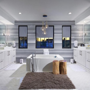Inspiration for a contemporary freestanding bathtub remodel in Orange County with a vessel sink