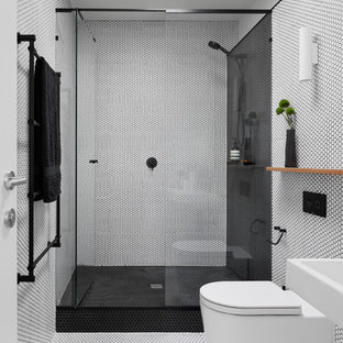 Mid-sized contemporary bathroom in Melbourne with an alcove shower, black and white tile, mosaic tile floors, white floor and a hinged shower door.