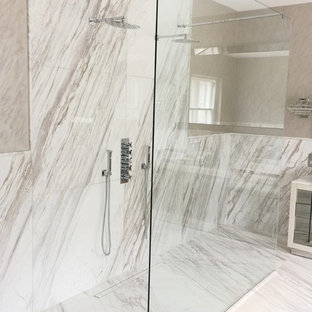 Large trendy kids' white tile and marble tile marble floor and white floor doorless shower photo in London with white cabinets, white walls and marble countertops