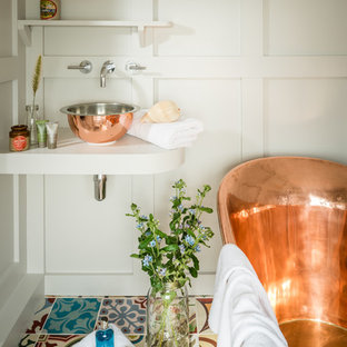 Inspiration for a small country bathroom in Dorset with a freestanding bath, ceramic flooring, a vessel sink and multi-coloured floors.