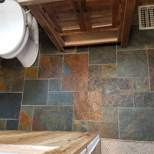 Bathroom - small rustic 3/4 multicolored tile and slate tile slate floor and multicolored floor bathroom idea in Cincinnati with louvered cabinets, light wood cabinets, a bidet, beige walls, a vessel sink and wood countertops