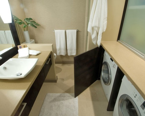 inspiration for a contemporary bathroom remodel in hawaii with solid surface countertops and a vessel sink