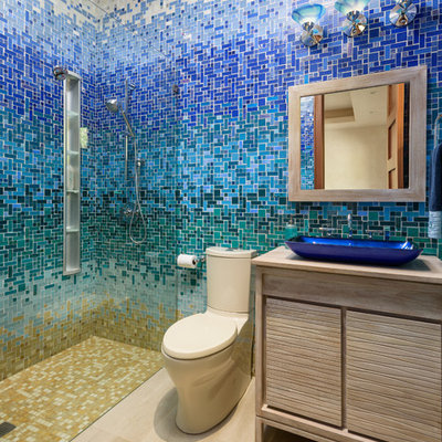 Walk-in shower - tropical 3/4 beige tile, blue tile, green tile, white tile and mosaic tile beige floor walk-in shower idea in Hawaii with flat-panel cabinets, light wood cabinets, a vessel sink, wood countertops and beige countertops