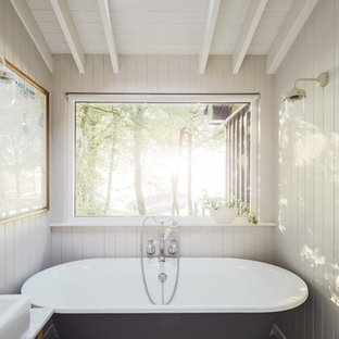 Inspiration for a small rustic bathroom in Other with cement flooring, multi-coloured floors and a freestanding bath.