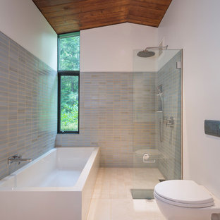Inspiration for a mid-sized midcentury modern master blue tile, green tile and ceramic tile porcelain floor and beige floor bathroom remodel in Boston with flat-panel cabinets, light wood cabinets, a wall-mount toilet, white walls, an undermount sink, engineered quartz countertops and white countertops