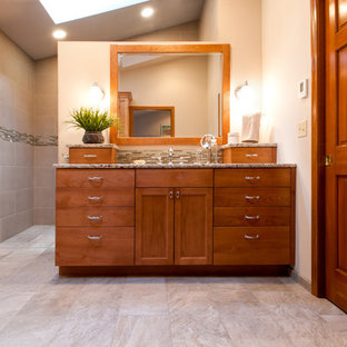 Design ideas for an arts and crafts bathroom in Seattle with an undermount sink, medium wood cabinets, an open shower, beige tile, mosaic tile, beige walls and porcelain floors.