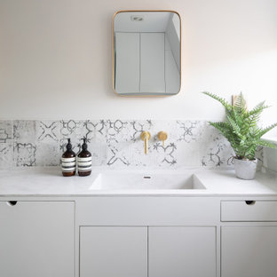 Wall hung taps and patterned splashback tiles